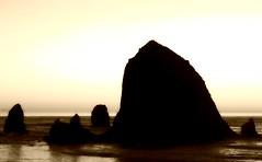 Haystack Rock Sunset (pete4ducks) Tags: travel winter sunset sky blackandwhite seascape beach water sepia oregon waves weekend pete oregoncoast geology haystackrock 2009 picnik vibrance goldenratio anawesomeshot ortonish pete4ducks