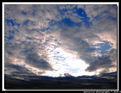Threatening becloud (MannyRios) Tags: nyc sunset shadow sky mist ny newyork blur bird fog clouds canon haze mask cloudy mason curtain overcast scre