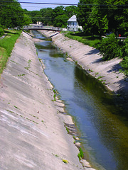 Almost all of the Kinnickinnic River from Sixth Street, where this photo was taken, upstream to 43rd Street is lined with concrete. ~photo Jennifer Yauck