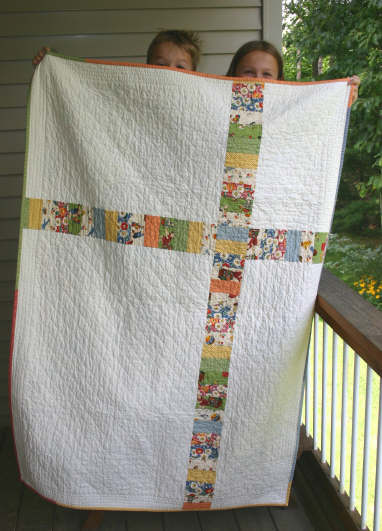 Quilt back with little helpers - Look and Learn Quilt