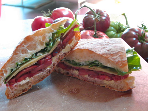 tomato, cheddar and arugula on fresh baked ciabatta