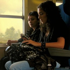Curiosity (Osvaldo_Zoom) Tags: railroad travel girls italy students girl beauty train canon bag wagon women cellphone journey cellulare curious curiosity treno calabria commuters handphone trenitalia g7 railroadcar krizia