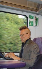 Typing (georgeupstairs) Tags: people train rail railway passenger goldblade johnrobb merseytravel transpennineexpress
