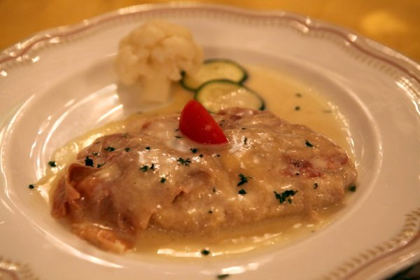 """Cotoletta alla petroniana con tartufo davvero"", veal wrapped in prosciutto, lightly breaded, fried, cheese and truffles and sauce.  OH MY."
