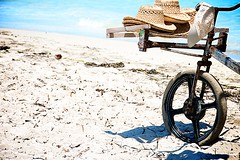 Beach to Beach Salesman (lynn.h.armstrong) Tags: ocean camera wood blue vacation white ontario canada seaweed green art beach hat bike wheel metal azul lens geotagged photography photo interesting mac sand beige aperture nikon rust long peeling paint flickr waves zoom south spokes cuba may hats straw lynn h iberostar laguna nikkor varadero armstrong stormont vr salesman handlebars afs gettyimages dx sault ingleside 2011 ifed 18200mm f3556 attributionnoderivs vrii d7000 ccbynd lynnharmstrong requesttolicence