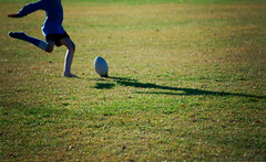 Rugby (borealnz) Tags: rugby ball kid child shadow running kicking sock onesock bootless nz newzealand otago grass paddock field barefoot nov13 dec13 jan14 getty aug14 march15 sept15 march16 july16 feb17