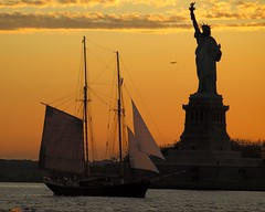 Statue of Liberty and Tall Ship, New York Harbor (jag9889) Tags: new york nyc sunset ny newyork monument colors airplane landscape bay harbor boat newjersey ebay sailing ship dusk manhattan nj landmark upper national sail tall statueofliberty hudsoncounty 2011 4july1776 y2011 jag9889