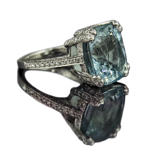 jeweller in cushion cut aquamarine engagement ring