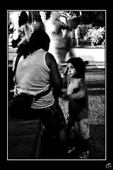 Le regard de l'enfant... (Co G.) Tags: portrait people blackandwhite bw white black girl rose french kid riviera noir child noiretblanc cannes cte nb ctedazur petal co enfant fille blanc cog flou azur regard coline rosepetal croisette frenchriviera garang colinegarang