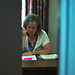 Looking at Barb Beverly work at her desk in Neptune Hall through her door during the busy season for NIU office workers