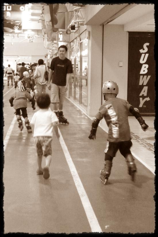 Daddy rollerblading