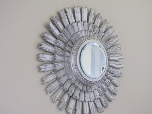Wall hanging that I added a mirror to and spray painted silver
