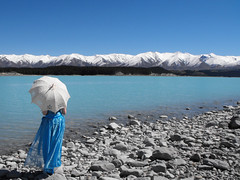(Nic Temby) Tags: blue newzealand portrait snow mountains t rocks stones parasol mackenziecountry onlocation lakepukaki pukaki formaldress bluedress southcanterbury rhoborohills