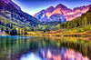 Maroon Bells at Sunrise with Lake Reflections (NikonKnight) Tags: trip travel blue sunset red sky sun mountain lake snow ski mountains reflection green water beautiful yellow clouds bells sunrise landscapes nikon colorado photographer shadows bell crystal maroon no lakes magenta photographers peak visit glacier alpine co belle wilderness aspen snowmass belles lightroom maroonbelles maroonlake d40