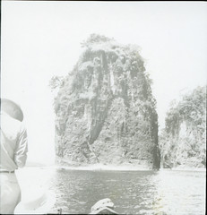 Edward Beckwith photographing a small rock island off Kahatola Island