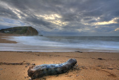 West bay dorset (Mrs benjita1) Tags: wood sea england cloud storm west beach water clouds canon bay coast sand waves seascapes cliffs driftwood dorset hdr jurassic drift westbay jurassiccoast photomatix 400d canon400d