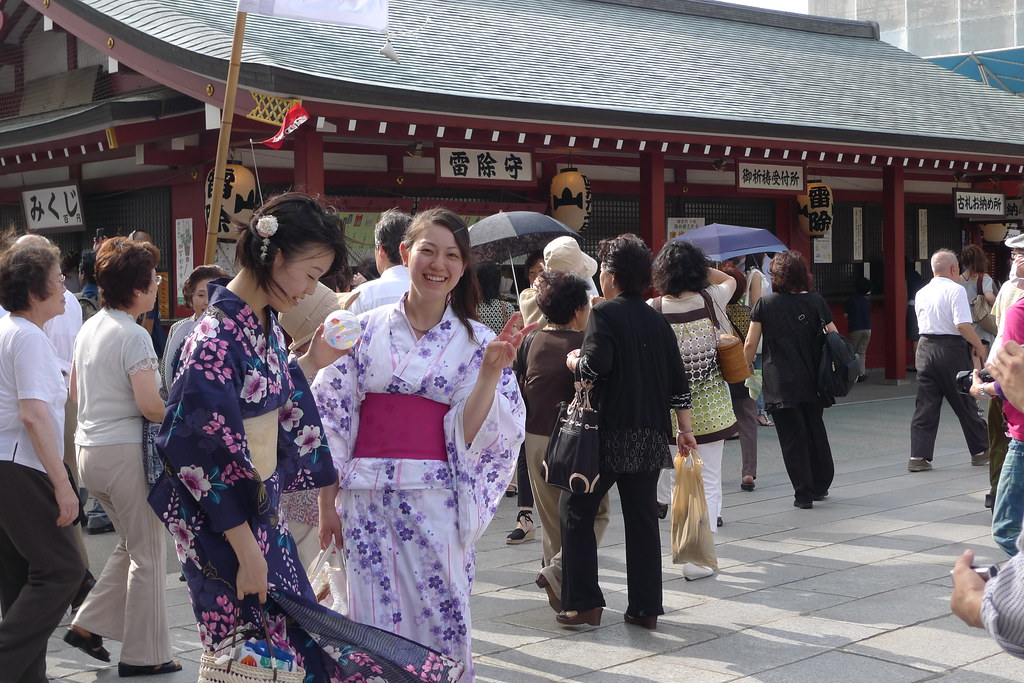 Candid photos of two girls in Yukata at senso-ji temple during hozuki ichii