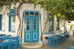Door and tables (ebruytm) Tags: turkey ada trkiye mavi bozcaada ege turchia kap pencere platinumheartaward homersiliad