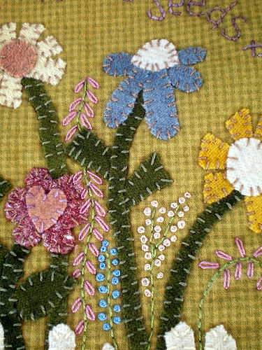 Hand-Appliqued Wool Flowers on Quilt