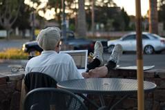 Morning Coffee and  Laptop (nosha) Tags: california ca morning summer portrait coffee hat 50mm glasses nikon shoes august moustache paloalto f18 palo alto 2009 peets lightroom 50mmf18 blackmagic nosha 0ev 1400sec nikond40 1400secatf18 summer2009 californiaoregon2009