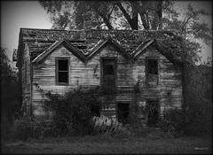 Spook House (MEaves) Tags: blackandwhite bw rot abandoned monochrome farmhouse neglect illinois moody pentax eerie spooky forgotten weathered distressed decayed blackdiamond antiquity disrepair allhallowseve sigma70300 blackwhitephotos k20d bwartaward goldstaraward pentaxk20d pentaxart