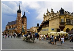 Do Widzenia Poland * (Nathan Bergeron Photography) Tags: windows sky horses people brick church stone architecture clouds buildings geotagged europe artist spires gothic poland krakow medieval tourists unesco worldheritagesite spire getty krakw cracow oldtown renaissance picks easterneurope sukiennice drapershall horseandcarriage clothhall stmarysbasilica mainmarketsquare yearinfrance 18122009 geo:lat=50062366 geo:lon=1993761