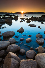 Gold-N-Blue Country - Lake Tahoe, Sand Harbor, Nevada (Jim Patterson Photography) Tags: statepark longexposure travel blue sunset sky usa sun lake mountains color nature water vertical landscape photography gold colorful natural cove nevada shoreline scenic wideangle laketahoe boulders shore lee vista sunburst polarizer sierranevada gitzo freshwater reallyrightstuff sandharbor remoterelease nikkor1224mm graduatedneutraldensityfilter goldnblue nikond300 markinsm20ballhead jimpattersonphotography carsoncitycounty jimpattersonphotographycom seatosummitworkshops seatosummitworkshopscom
