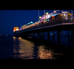 Paignton Pier At Night (©Komatoes) Tags: uk sea reflection water night 50mm lights pier nikon waves f14 g explore devon handheld nikkor afs 50mmf14 paignton 377 d40 nikond40