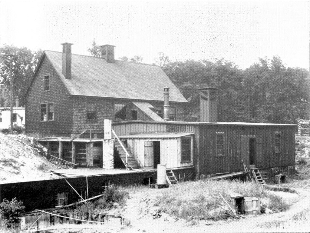1903.  Rear view of the Lawrence Experiment Station showing filter house and some of the early intermittent sand filters.  The mound in the right foreground shows the 1st covered intermittent sand fil