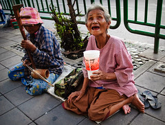 singing to survive (Adrian in Bangkok) Tags: life street people urban colour asian thailand asia raw faces bangkok culture streetphotography photojournalism documentary social gritty thai metropolis streetphoto society