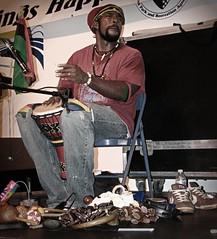 percussionist (MzMullerz) Tags: musician desaturated reggae percussionist inthezone strangerportrait dancininthestreets downtownstuart mzmullerz sweetjustice neversawhimopenhiseyes