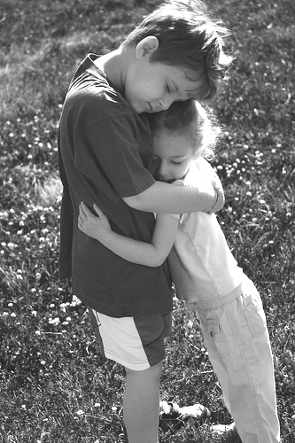 little kids hugging
