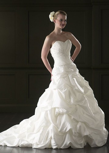 Strapless style wedding dress and embroidery.