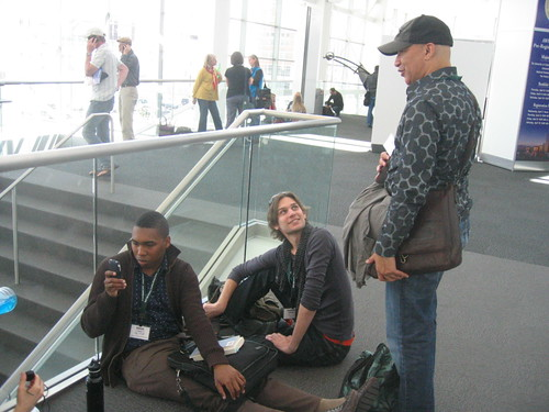 Saeed Jones (snapping a photo), a friend, Cyrus Cassells