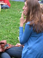 Enjoying a jazz cigarette (silverfuture) Tags: chicago sunday pitchfork unionpark girlsmoking jazzcigarette pitchforkmusicfestival2009 thattagsforyoupervs