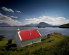 Red roofed cottage on the banks of Loch Torridon, Wester Ross. (freeskiing) Tags: blue sea summer grass clouds scotland rocks may dramatic explore torridon westerross sigma1020mm lochtorridon highlandsofscotland ndgrad09 redroofedcottage benthorburn