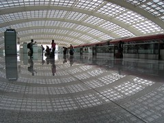 Terminal 3 (SqueakyMarmot) Tags: china travel reflection geometric beauty architecture asia beijing curvy terminal3 glassroof subwaycars beijingcapitalinternationalairport airportexpressline lpceilings