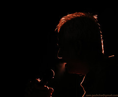 A Voice Against The Darkness... (SamikRC) Tags: lighting light black silhouette delete10 delete9 delete5 delete2 flickr power singing delete6 delete7 smoke father save3 voice delete8 delete3 delete delete4 save save2 explore speaker microphone outline rim drama recording rimlight voiceover samikrc samikroychoudhury