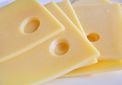 Slices of cheese. (alika1712) Tags: color macro nature yellow horizontal closeup cheese breakfast lunch switzerland foods healthy pattern close hole swiss objects sandwich fresh gourmet part snack vegetarian backgrounds appetizer product section slices protein textured freshness delicatessen dieting ingredient emmental porous maasdam