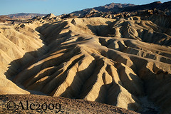Zabriskie (Ale*) Tags: california park sunset shadow parco color yellow nationalpark sand tramonto colore ombra ale trails erosion giallo clay valley mustard deathvalley badlands geology southerncalifornia gravel ridges mustardyellow deathvalleynationalpark inyo inyocounty sentieri calanchi senape desertpavement canaloni giallosenape geomorphogy