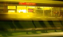 Open Through a Bus (cycle.nut66) Tags: lighting street winter light blur reflection wet water rain night umbrella four evening streak olympus aylesbury zuiko shimmer thirds evolt e510