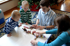The boys check out the ornaments as Mommy unpacks them
