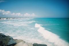 ponce inlet. (!HANNAH) Tags: ocean blue film beach water 35mm nikon rocks waves daytona n55 nikonn55 ponceinlet nikonf55 f55