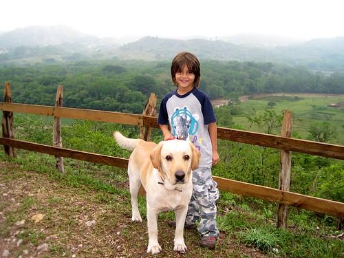 kid and a dog in hacienda san lucas copan honduras