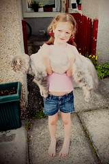 Scottish neighbour's kid with my giant cat (sim malta) Tags: girl yard cat big barefoot pigtails