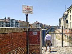 _1015943 (j.keller1) Tags: italy man brick sign buildings river walking florence gate italia riverside firenze arno pontevecchio topaz divieto topazadjust