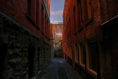 Chain Gang Alley (Brandon Godfrey) Tags: world pictures windows clouds stairs dark landscape photography photo amazing fantastic alley scenery downtown bc shot photos shots pics earth britishcolumbia sony bricks picture bluesky scene images victoria alleyway creativecommons pacificnorthwest northamerica alpha dslr oldtown hdr highdynamicrange victoriabc bastionsquare outstanding a300 tonemapped singlerawfilehdr thechallengegame challengegamewinner dslra300 sonya300
