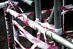 Wrapped scaffold (tonemonkey2002) Tags: abstract color construction scaffolding angles bleach tape scaffold vignette bypass sigma28200 sonydslra200
