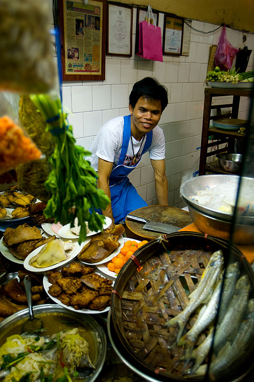 A cook at Khao Tom Jay Suay, a restaurant in Bangkok's Chinatown