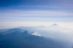 big hills (LeeRogers) Tags: blue sky bali mountains clouds indonesia landscape fly flying horizon flight peak aerial hills distant leerogers